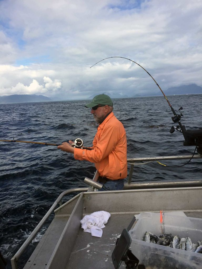 Henry fishing for salmon and halibut in Alaska